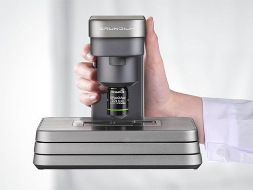 Grundium Ocus single slide scanner for digital pathology with integrated Olympus X Line objective producing high color accuracy digital slides for remote consultation and evaluation.